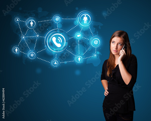 canvas print picture Pretty girl making phone call with social network icons