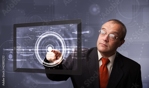 Businessman touching modern technology tablet