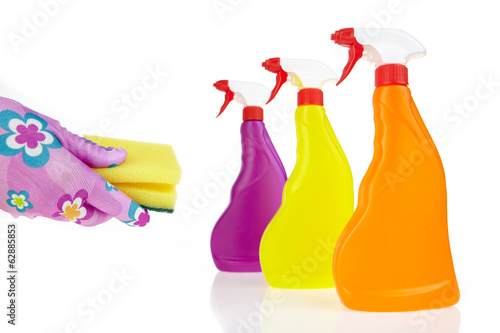 Colorful cleaning products isolated over white