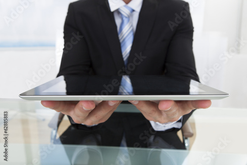 Businessman holding a tablet in his hands