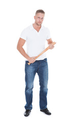 Bully or thug standing holding a baseball bat in his hands