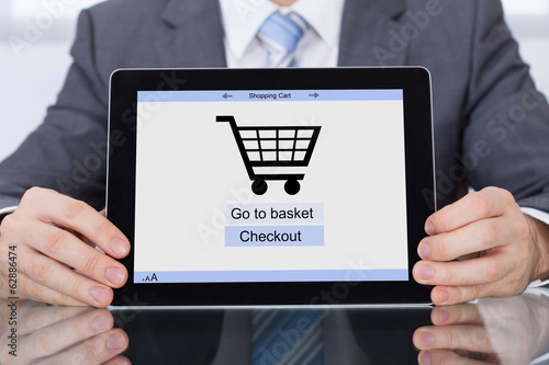 Businessperson Showing Online Shopping Application