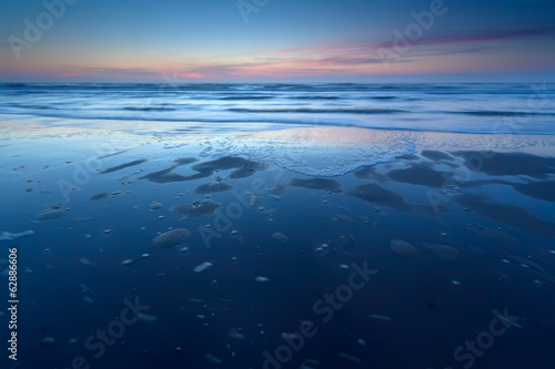 sunset over North sea coast at low tide