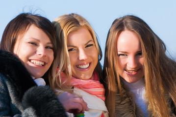 Portrait happy three beautiful young women