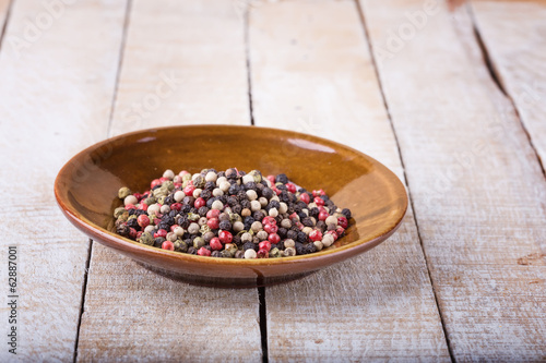Mixed pepper on wooden background