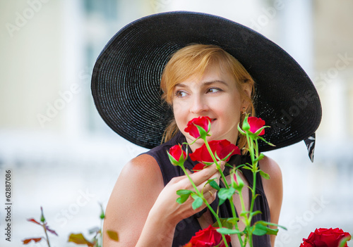 Attractive woman wearing big black hat