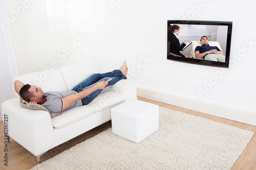 Man On Sofa Watching TV