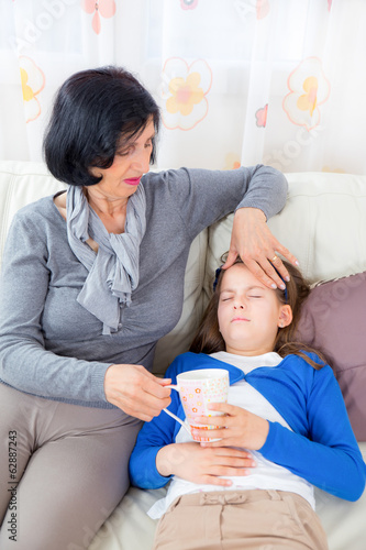 Grandmother is caring about ill granddaughter