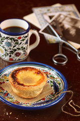 Portuguese Custard Tart with a cup of coffee
