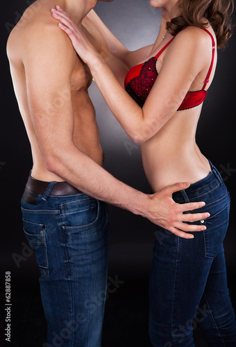 Midsection Of Passionate Couple Over Black Background