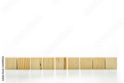 Row of nine blank wooden blocks