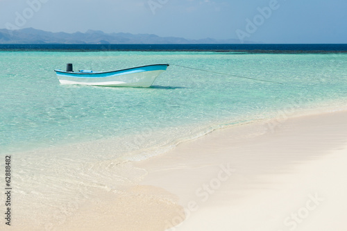 Boat moored in sea at beach