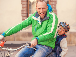 Emotional portrait father with cycling by bicycle together