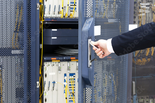 worker checking in the Telecommunication room