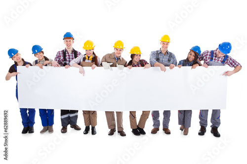 Group of workmen and women with a banner