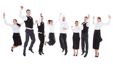 Waiters and waitresses jumping