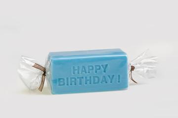 Happy birthday on a blue soap