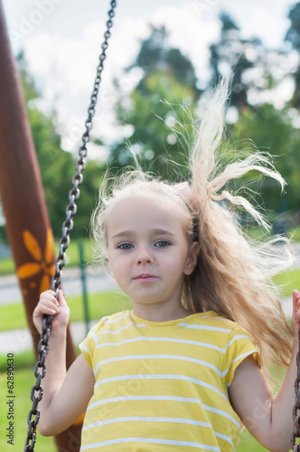 Swinging little girl