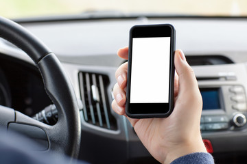 man sitting in the car and holding a phone with isolated screen