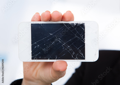 Person Holding Damaged Cellphone