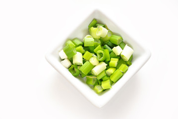 Green Scallions Chopped in a Square Bowl