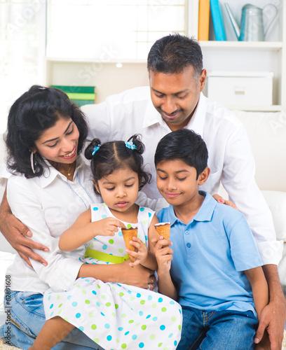indian family enjoying eating ice cream indoor