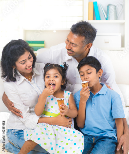 indian family enjoying eating ice cream indoor