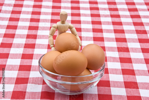 Manikin with eggs in a bowl