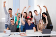 Happy College Students Celebrating Success In Classroom