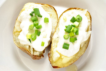 Baked Potato Halves with Butter, Cream and Scallions