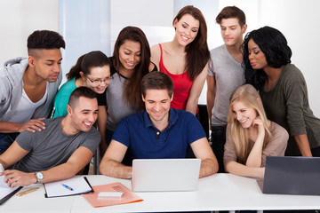 University Students Using Laptop Together