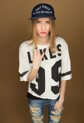 a young girl in a cap and a t-shirt
