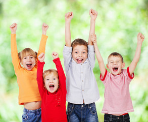 Happy children with their hands up
