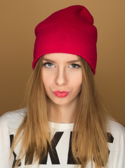 portrait of a young girl in a cap and a t-shirt