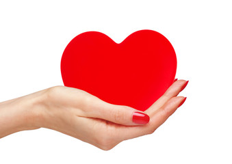 Red heart in woman hands isolated on white