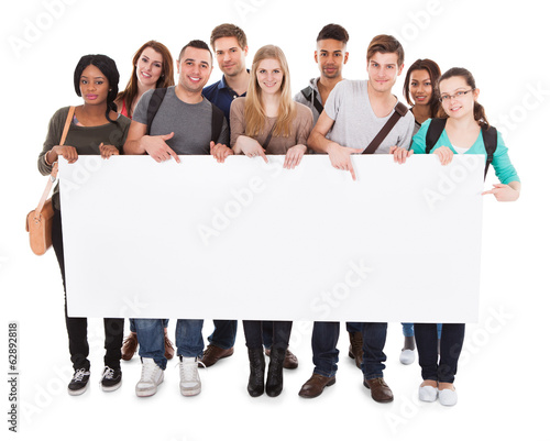 College Students Displaying Blank Billboard