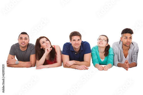 College Students Lying Over White Background