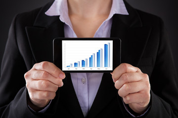 Businessperson Showing Graph On Cellphone