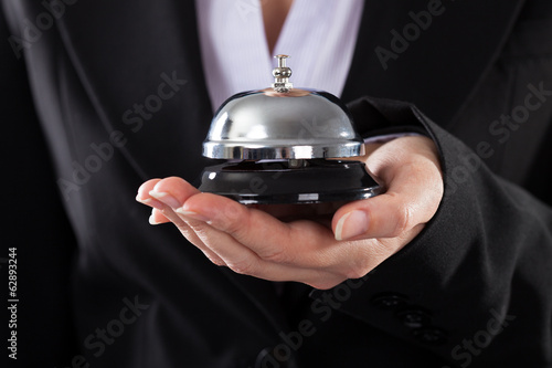Businessperson With Service Bell