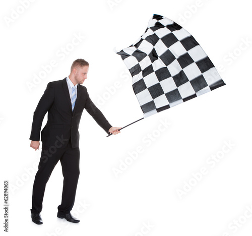 Conceptual image of a stylish young businessman waving a flag
