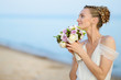 Bride walking along sea coast in wedding dress