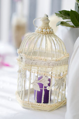 Fancy bird cage as a wedding decoration