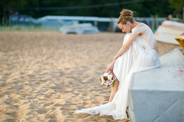 Beautiful bride sitting on a boat