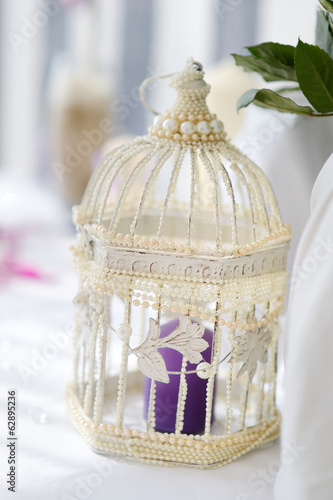 Fancy bird cage as a wedding decoration