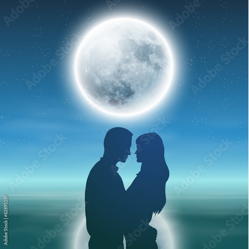 Sea with full moon and silhouette couple at night.