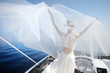 Happy bride on a yacht