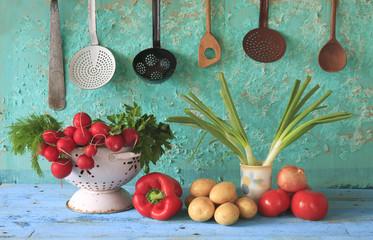 various vegetables and  retro kitchen utensils