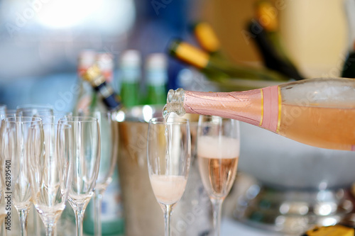 Pouring champagne into a glasses