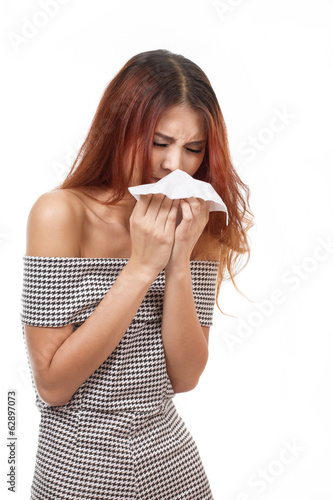 sick woman sneezing due to flu, cold, allergy