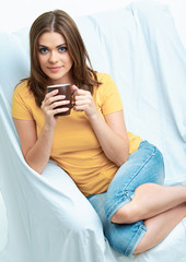 smiling woman sitting at sofa